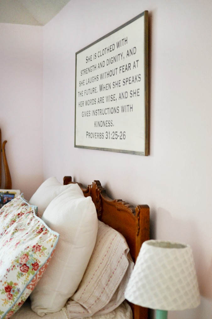 scripture sign hanging over vintage bed atthepicketfence.com