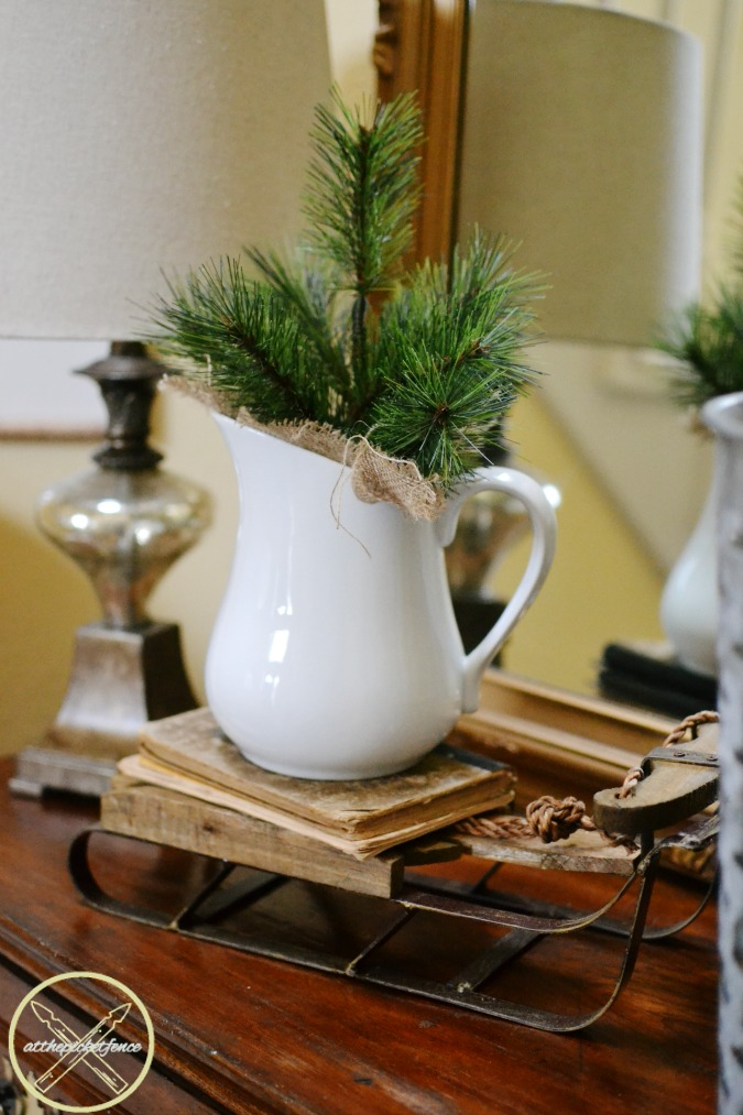 simple winter decor with a decorative sled atthepicketfence.com