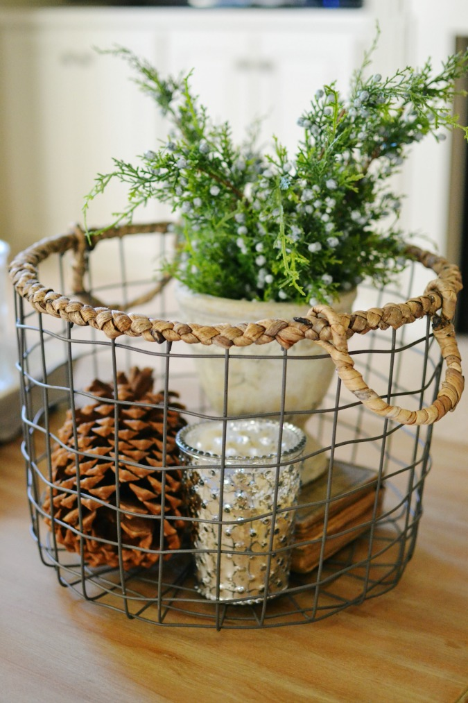 Fill a wire basket with decorative items. Easy and simple decorating! At the Picket Fence.com