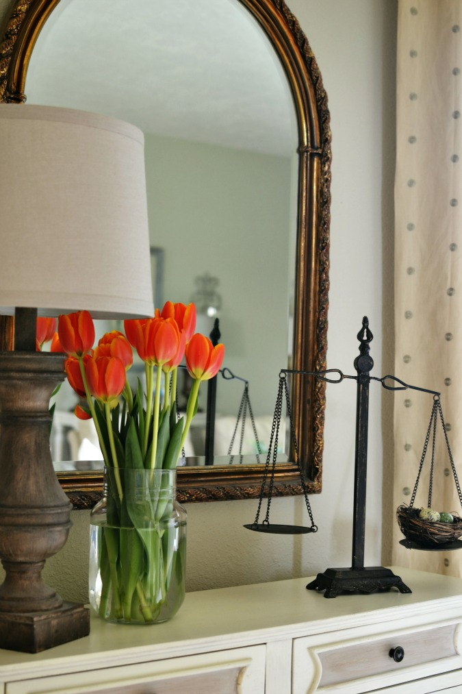A simple spring vignette with a balance scale
