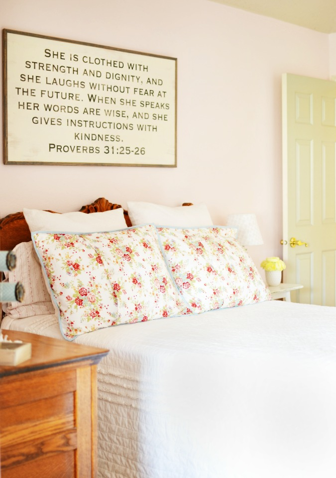 Bible verse typography sign over bed