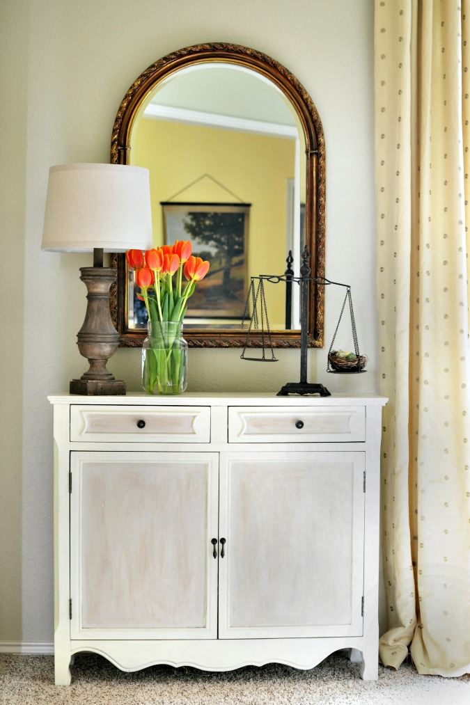 Paneled cabinet with two tones of paint atthepicketfence.com