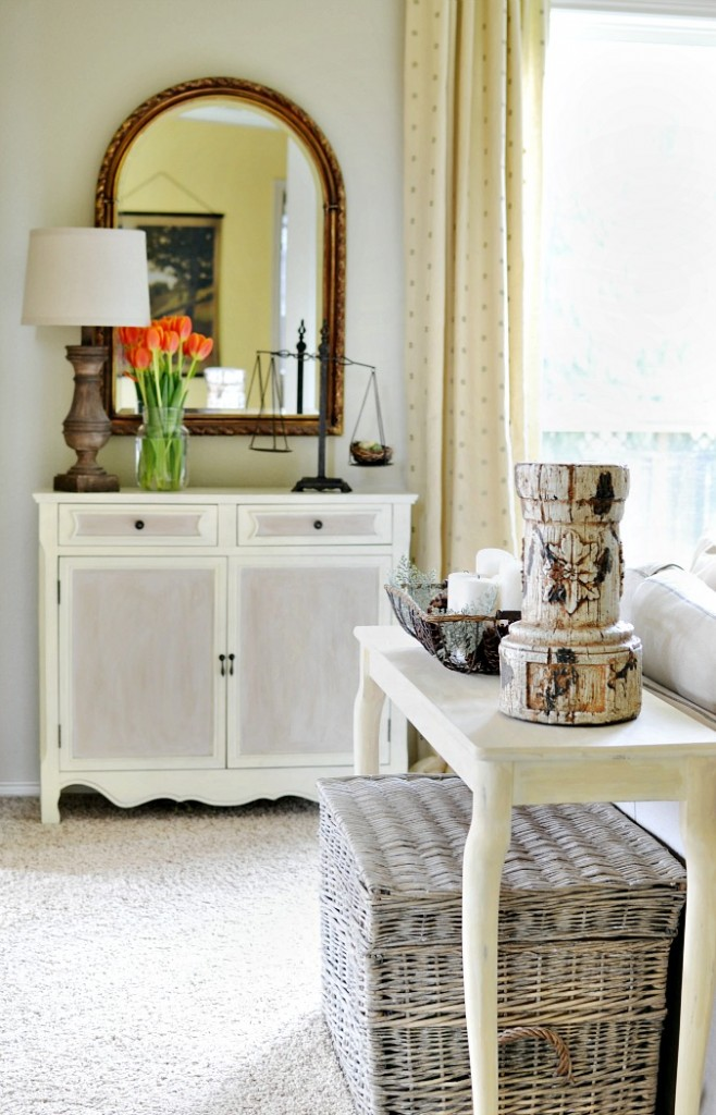 Sofa table and cabinet arrangement in family room