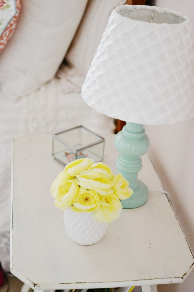 Use a vintage table as a nightstand atthepicketfence.com