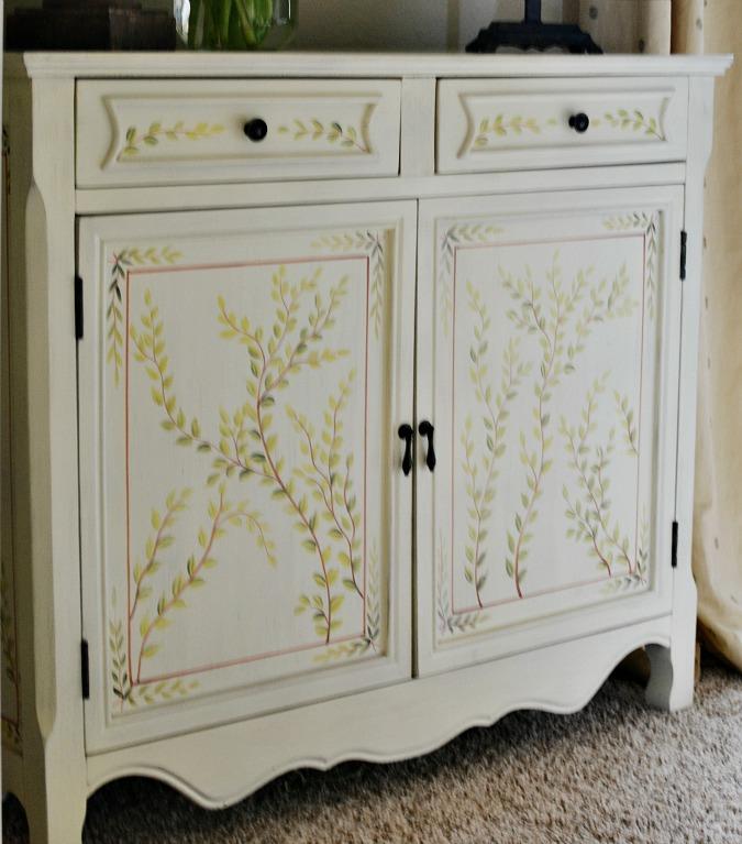 stenciled flower cabinet