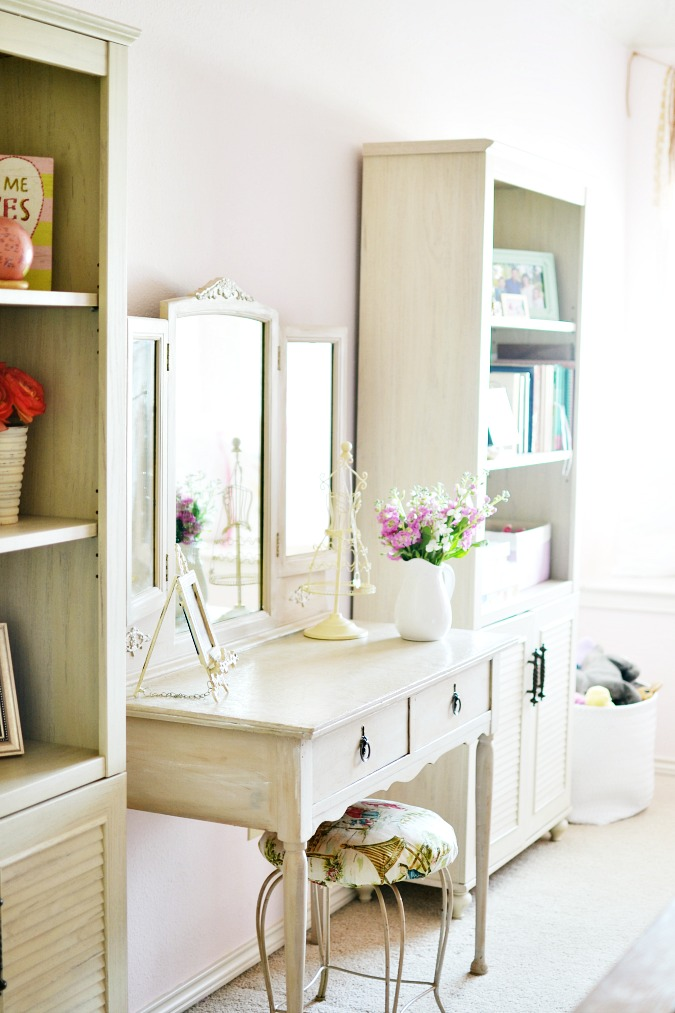 vintage vanity with stool in girls room