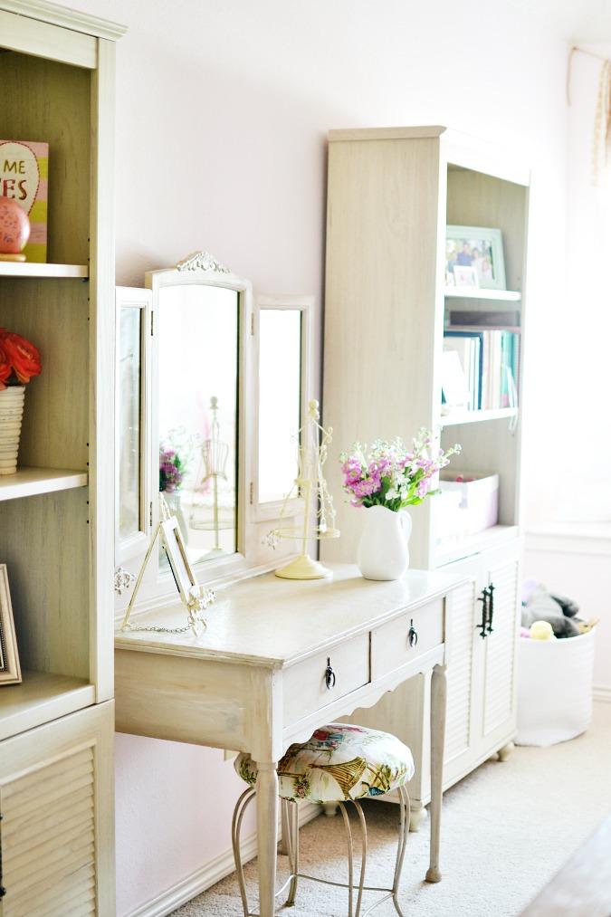 vintage vanity with stool in girls room