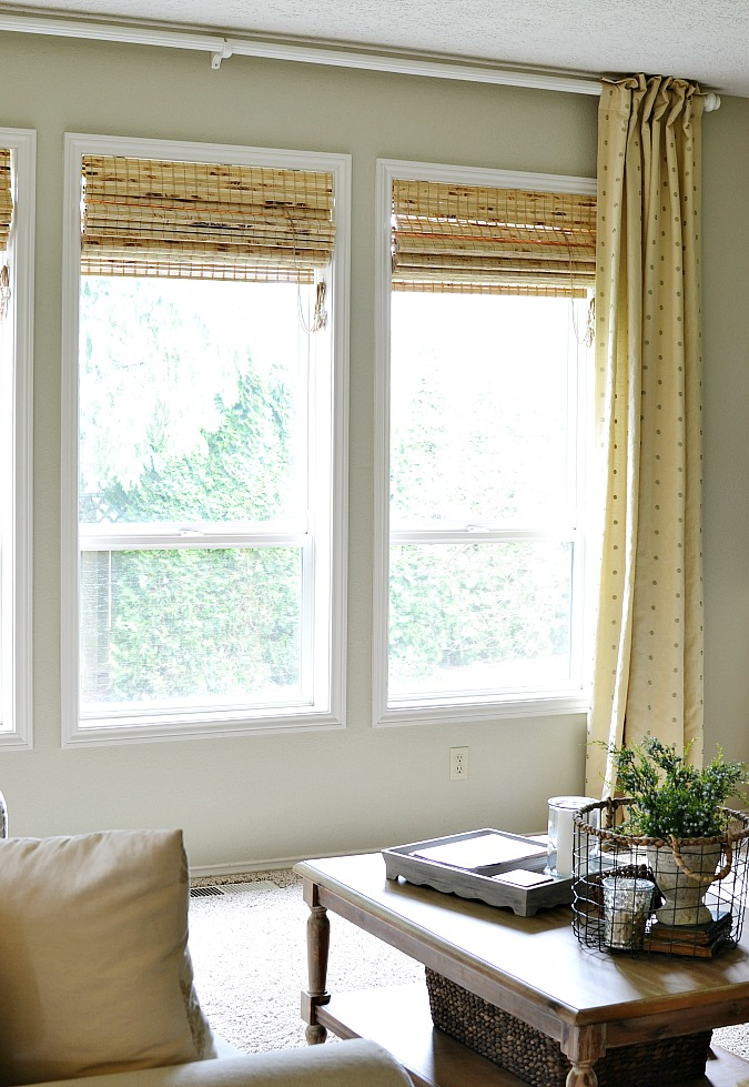 Bamboo roman shades with curtain panels