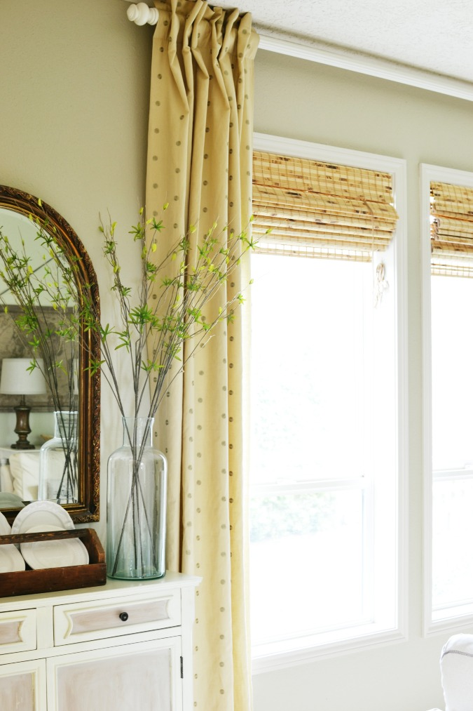 Using curtain panels with woven shades