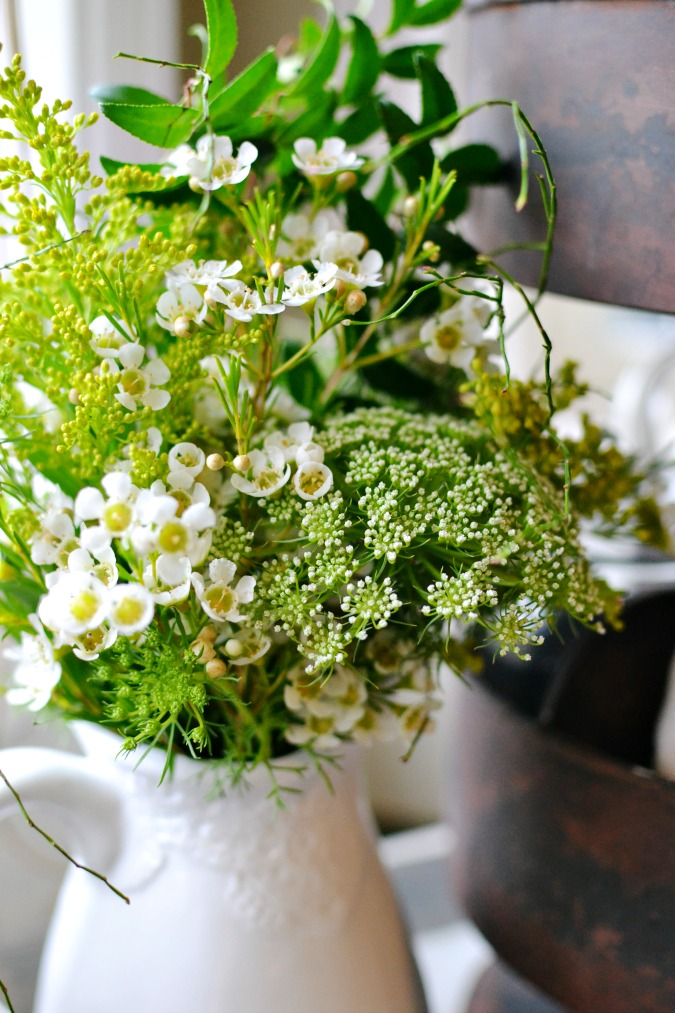 wildflowers in white pitcher