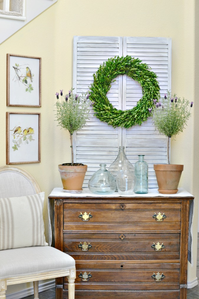 Shutter doors as a backdrop for simple french country decor