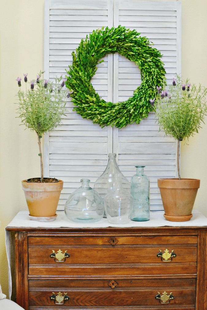 Simple French country inspired entry table decor with shutter doors