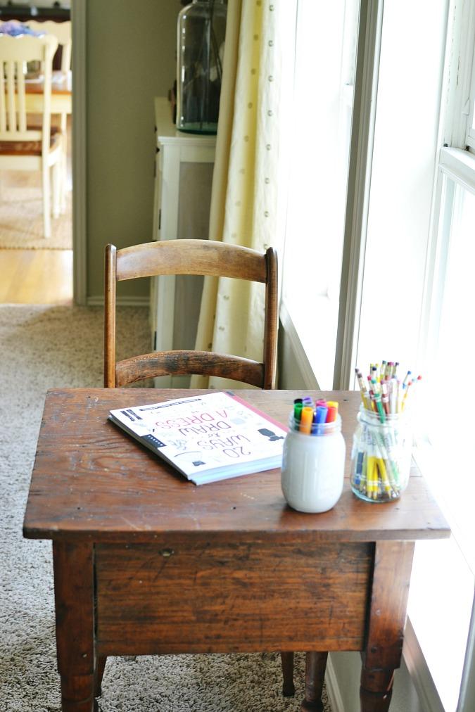 Antique table turned little art center