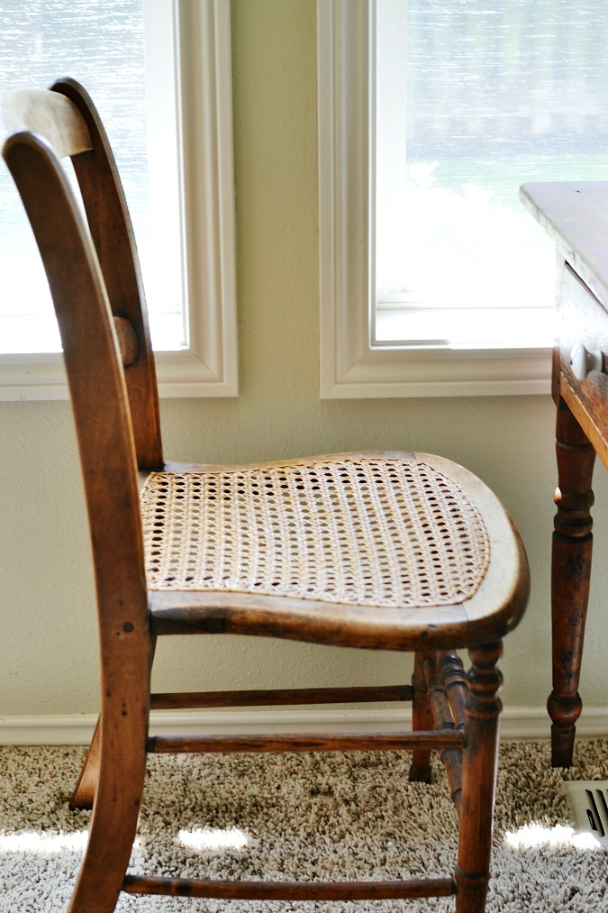 Little antique chair with a cane seat