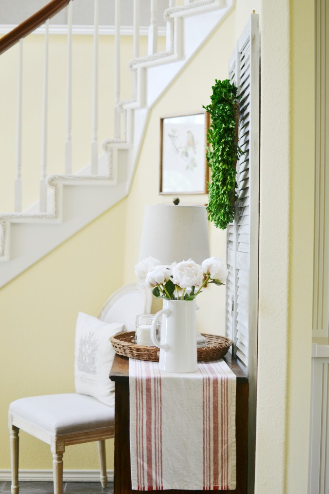 entry table with french country decor