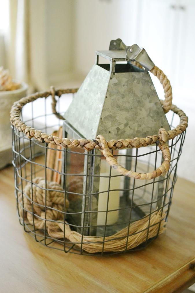 metal lantern in a wire basket as easy summer decor