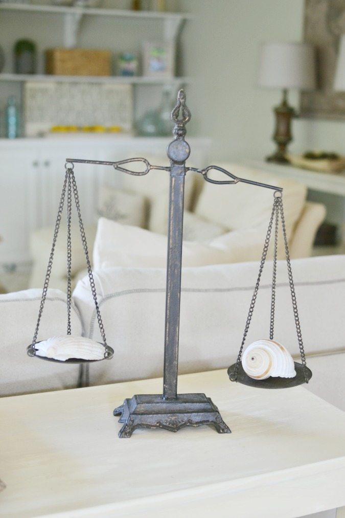 seashells on vintage balance scale