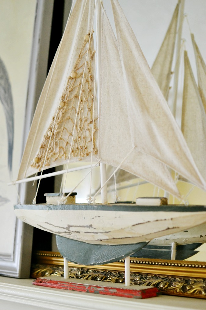 wooden sailboat on mantel