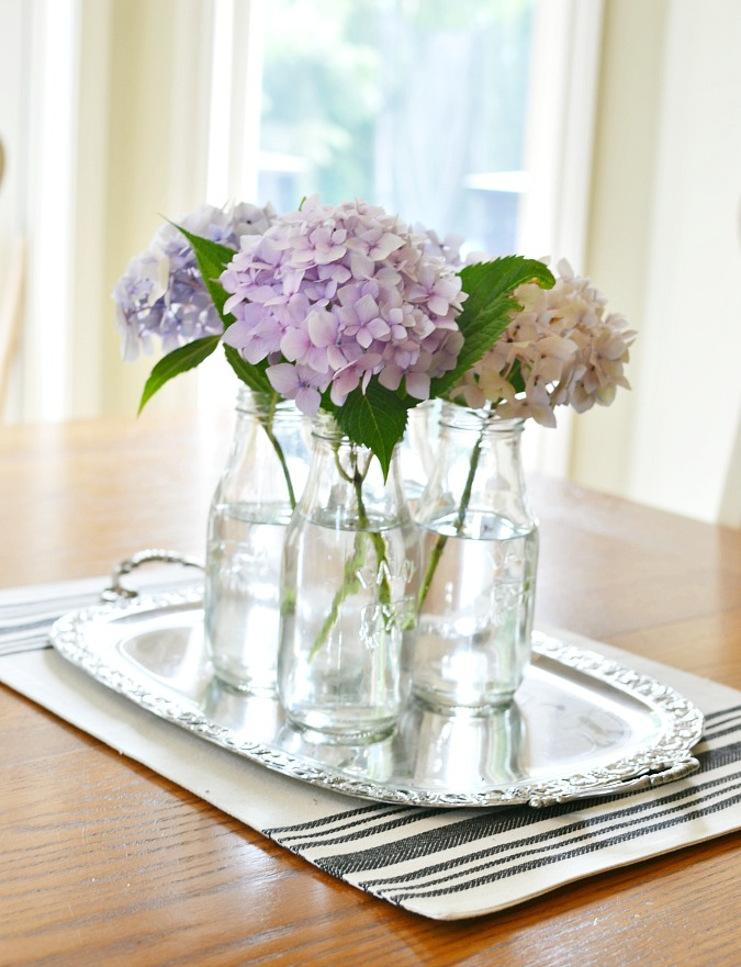 hydrangeas in milk bottles