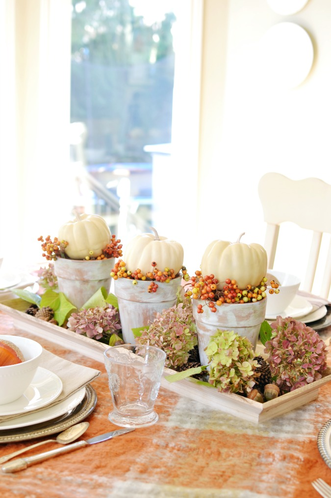Fall centerpiece with white pumpkins and hydrangeas