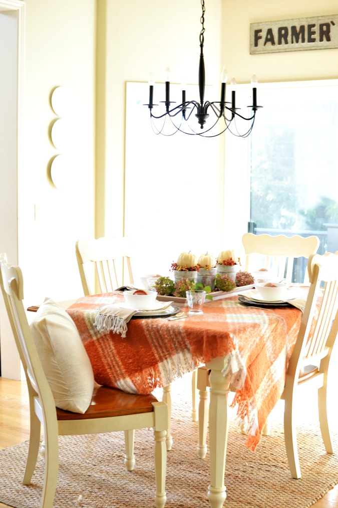 Fall dining table with plaid throw tablecloth atthepicketfence.com
