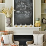 Cozy fall fireplace decorations with an oversized chalkboard