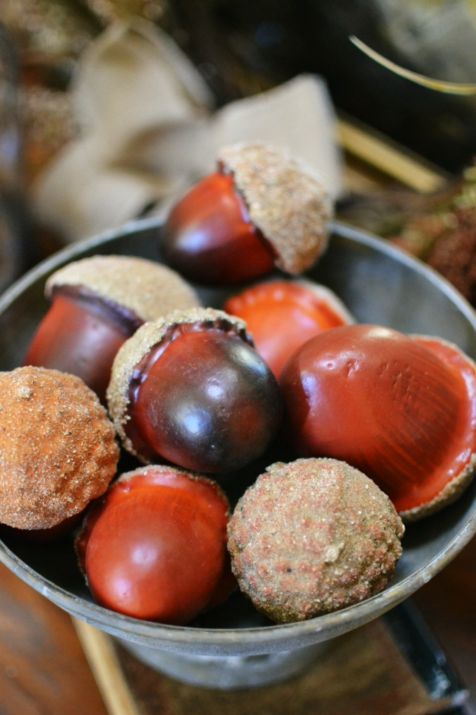 Large faux acorns with glittered caps