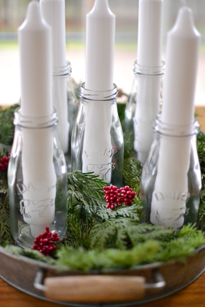 Advent candle arrangement with glass jars and white candles