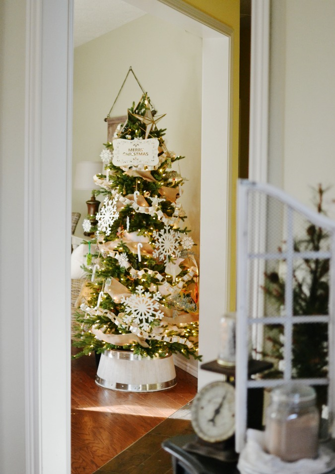 Christmas tree with white wood barrel tree stand