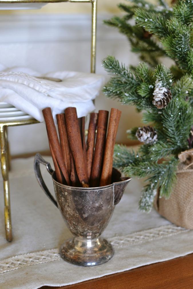 Cinnamon sticks in vintage silver creamer