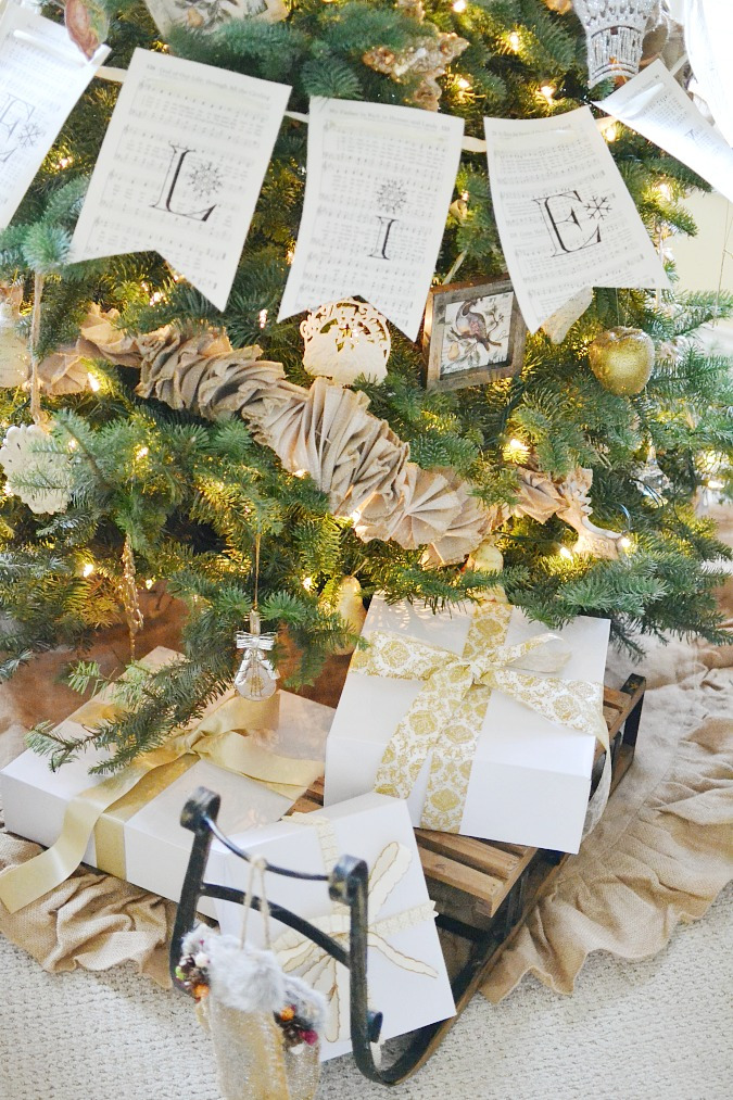 Presents on a sled and burlap ruffle tree skirt