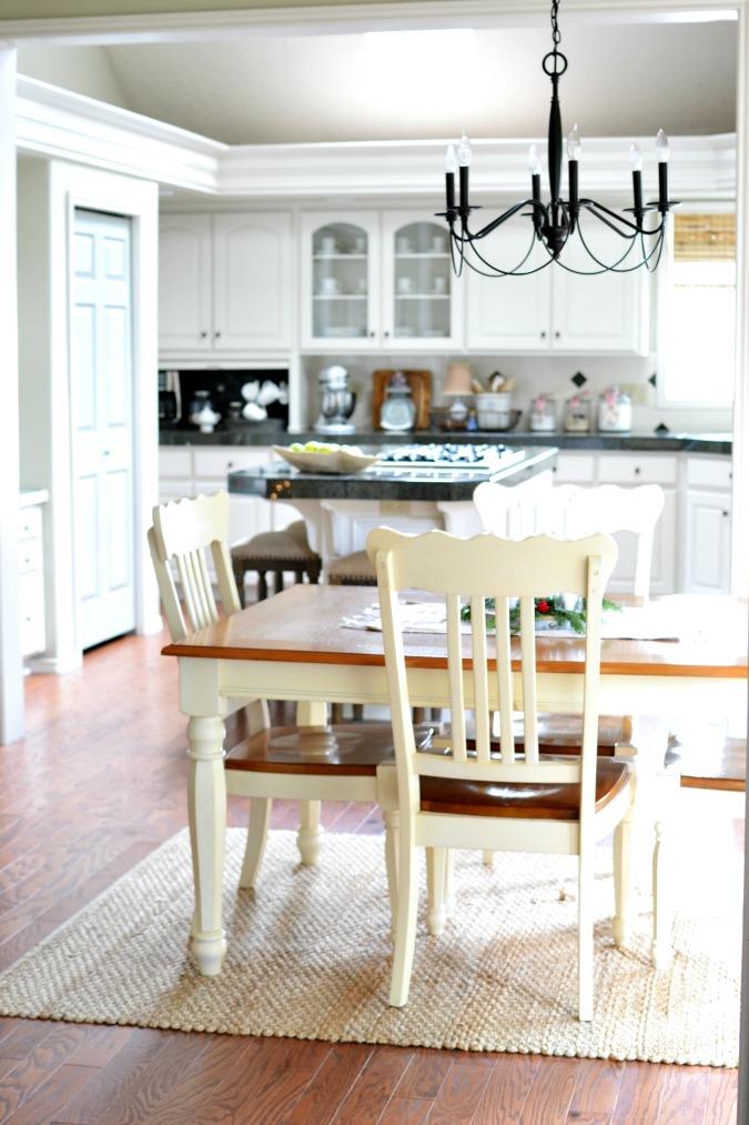 Breakfast nook next to kitchen with wood floors