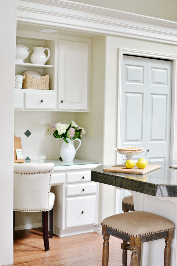 White kitchen with built-in desk