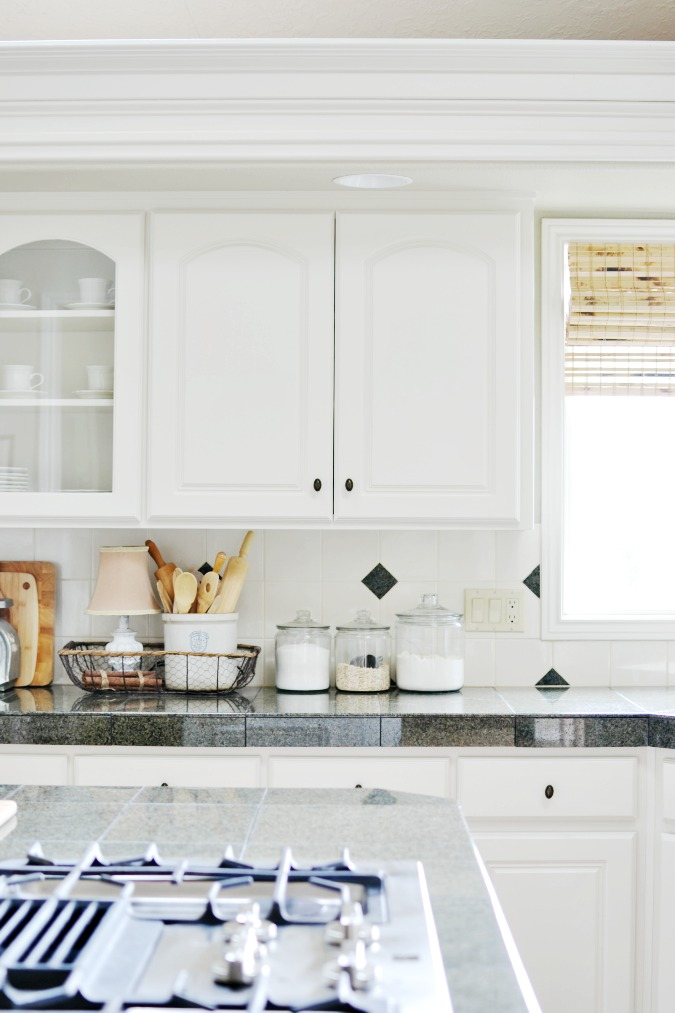 Farmhouse style kitchen with white cabinets