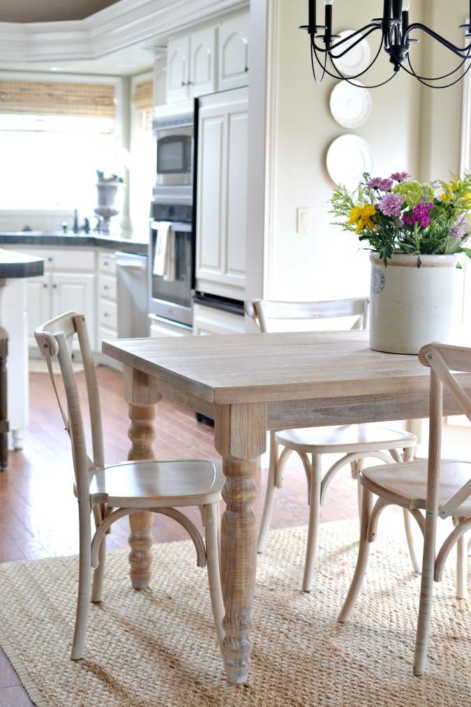 a farmhouse table and chairs atthepicketfence.com